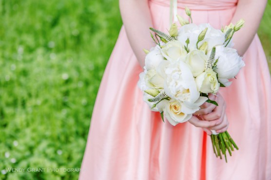 Peach Bridesmaid Dress with White Flower Bouquet