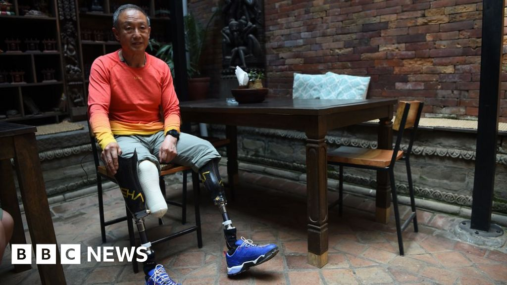 Double amputee climbs Everest 43 years after losing limbs