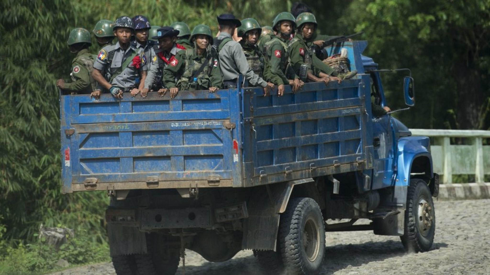 File image taken on 14 October 2016 shows armed military troops and police travelling in trucks through Rakhine State, Myanmar