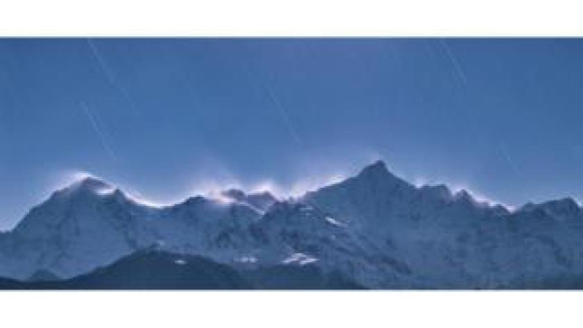 The stars beam down on to the Meili Snow Mountains