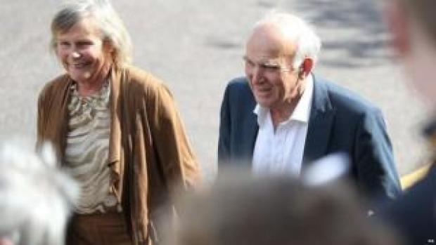 Sir Vince Cable arrives at the party's conference with his wife Rachel