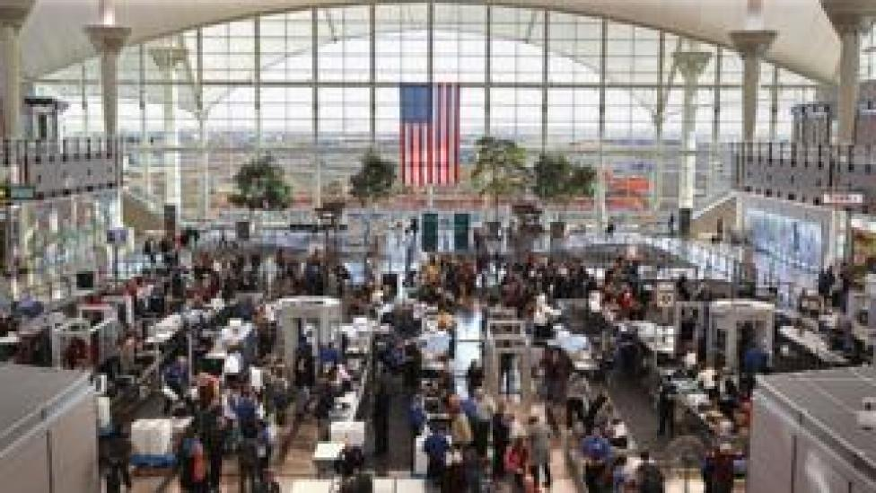 Passengers move through a main security checkpoint at the Denver International Airport on November 22, 2010 in Denver, Colorado.