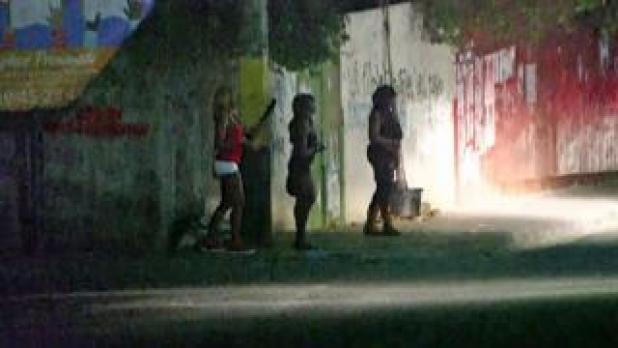 Women on a dark street in Haiti