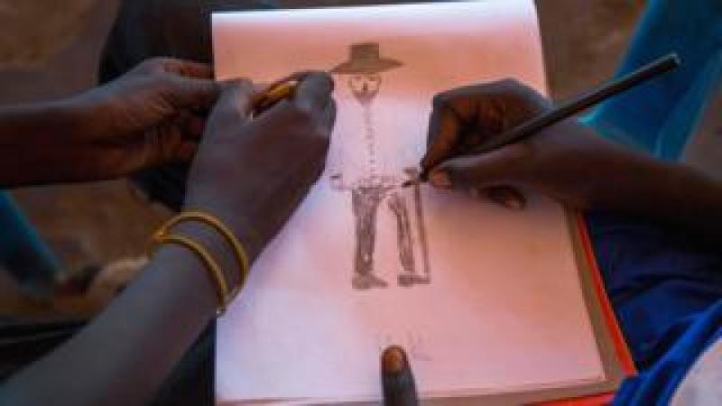 Children drawing in Juba, South Sudan - Tuesday 5 December 2017