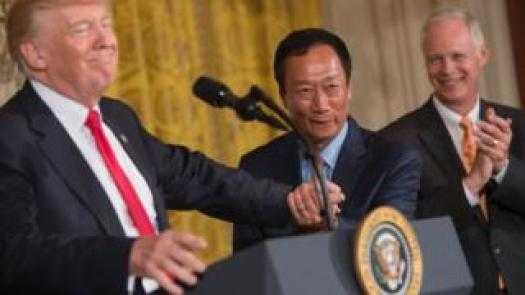 Donald Trump shakes hands with Terry Gou in July after announcing Foxconn's investment