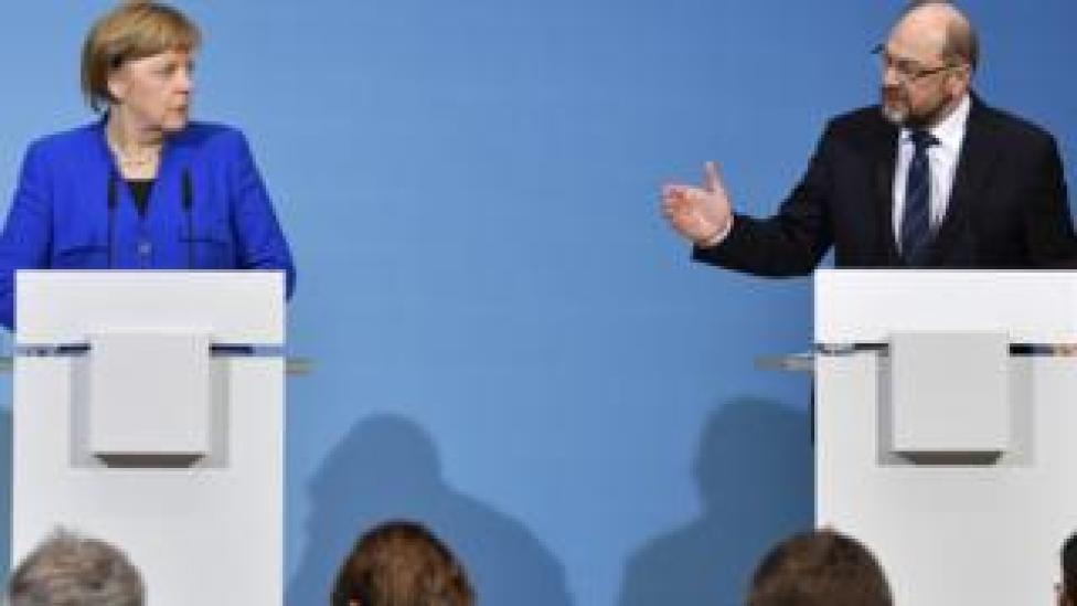 Rival German leaders: CDU's Angela Merkel (L) and SPD's Martin Schulz
