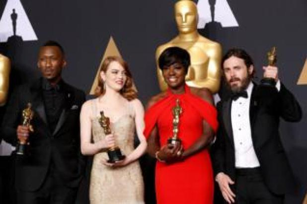 Best Supporting Actor Mahershala Ali, for Moonlight, Best Actress Emma Stone for La La Land, Best Supporting Actress Viola Davis, for Fences and Best Actor Casey Affleck for Manchester by the Sea hold their Oscars