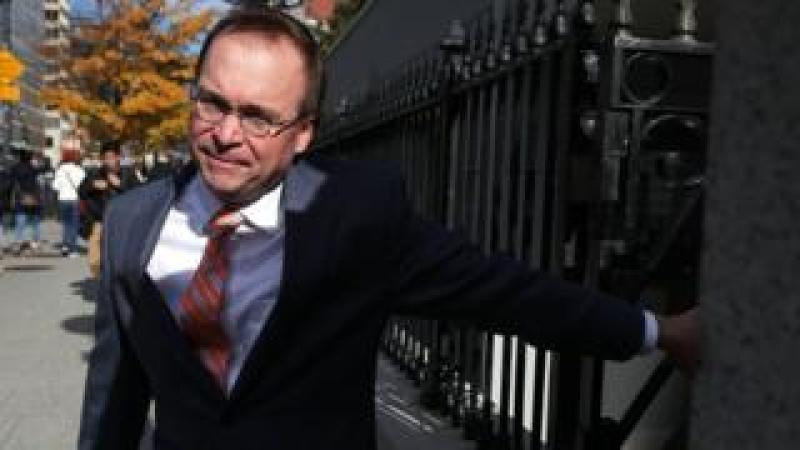 White House Budget Director Mick Mulvaney, President Donald Trump's pick for acting director of the Consumer Financial Protection Bureau, walks back to the White House from the CFPB building