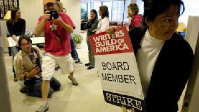 WGA member holds strike poster in 2008