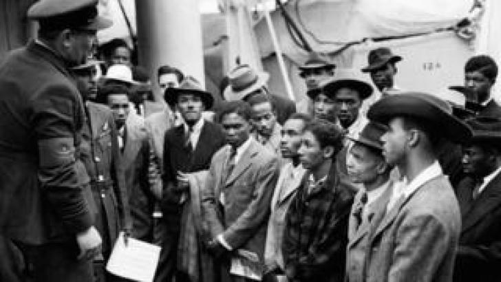 Jamaican (West Indian) immigrants welcomed by RAF officials from the Colonial Office after the ex-troopship HMT