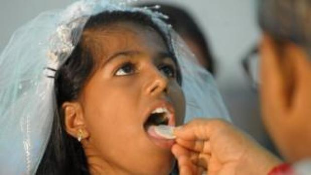 Indian girl receiving communion (July 2012)