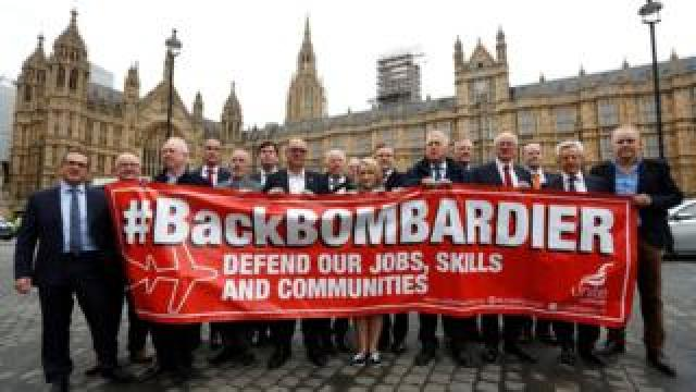 Members of Britain's Unite trade union protest outside the Houses of Parliament in support of Bombardier workers in London, Britain, October 11, 2017