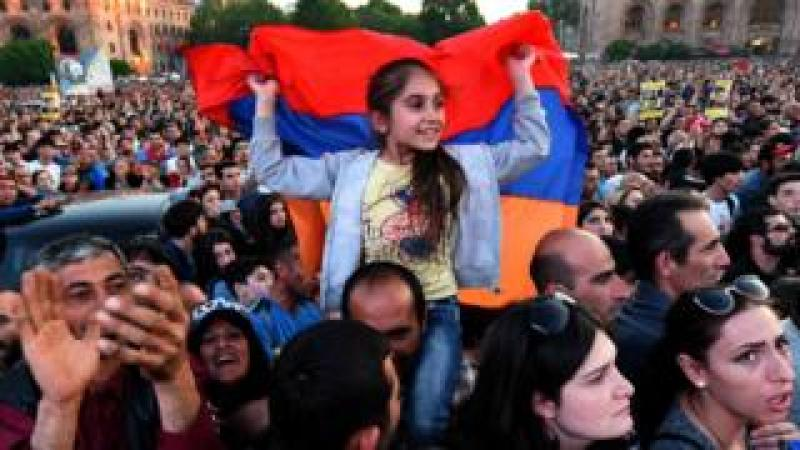 Supporters of Armenia's protest leader Nikol Pashinyan attend a rally in downtown Yerevan on April 26, 2018