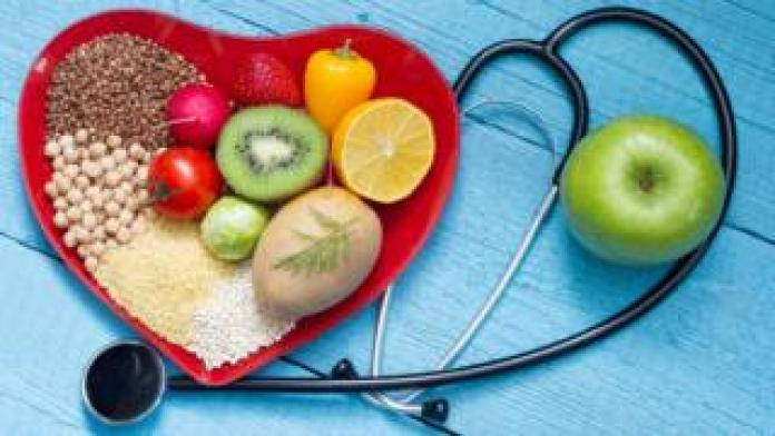 Stethoscope and bowl of healthy food