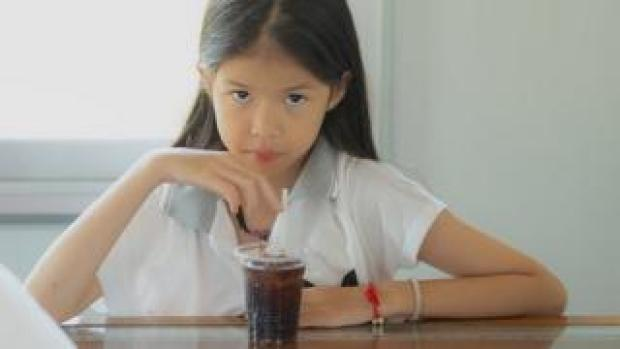 girl drinking fizzy drink