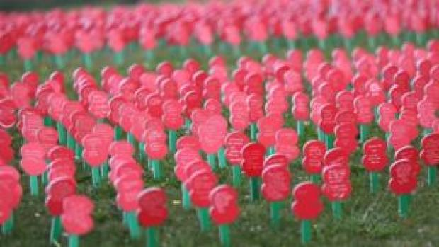 Poppies with messages written on them on display next to the Tyne Cot Commonwealth War Graves Cemetery, near to Ypres in Belgium