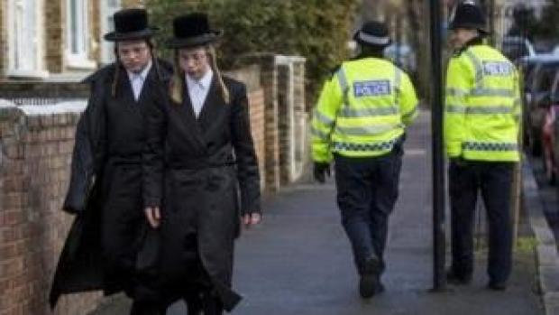Police and locals in Stamford Hill