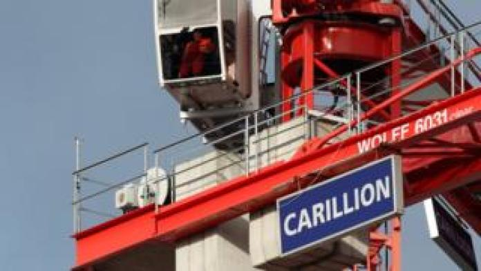 Crane with Carillion sign on it