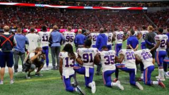 Buffalo Bills players kneel during the national anthem