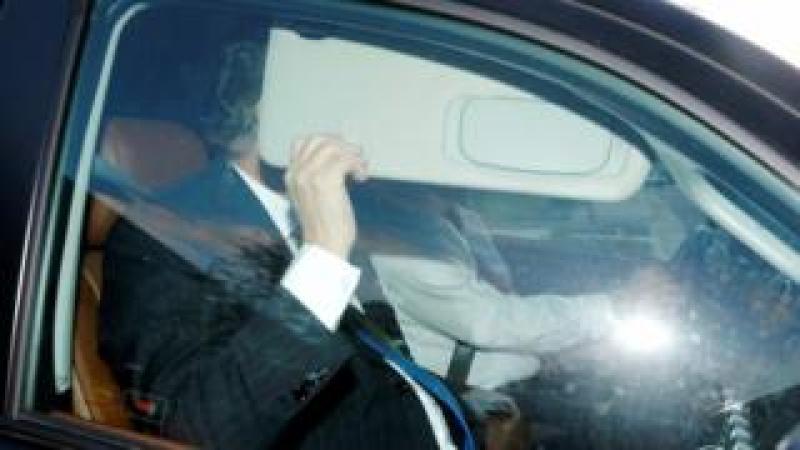 Paul Manafort hides behind his car visor