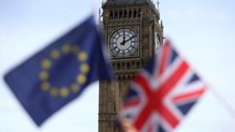EU and British flag outside Parliament