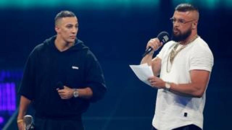 "German rappers Kollegah and Farid Bang receiving the ""Hip-Hop/Urban national"" award during the 2018 Echo Music Awards on 12 April"