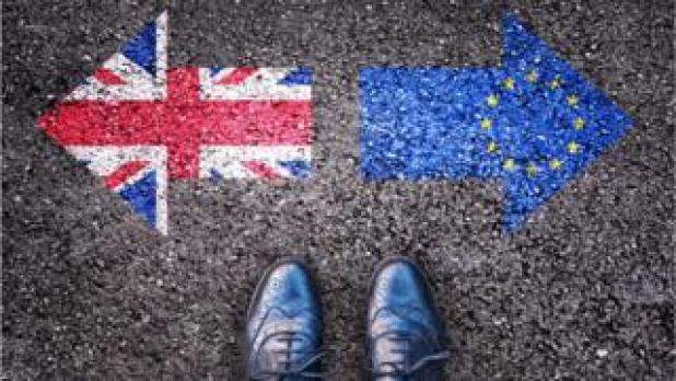A union flag pointing left and the EU flag pointing right