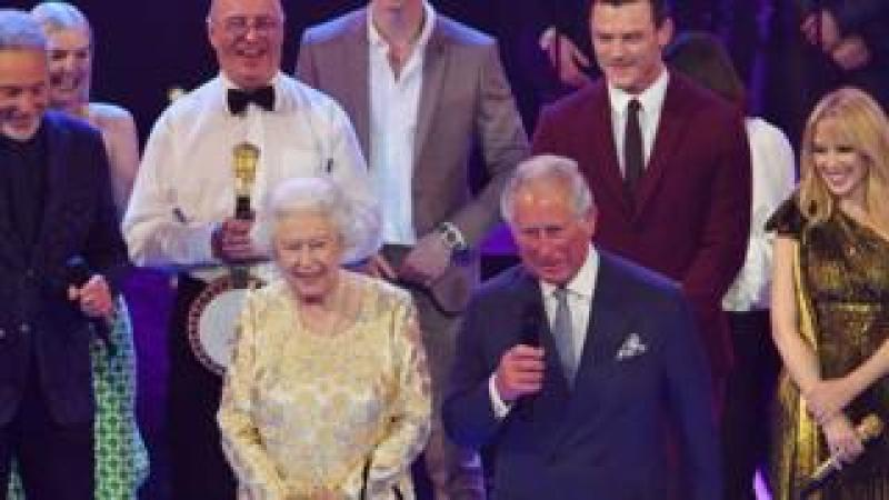 Queen Elizabeth II and Prince Charles on stage