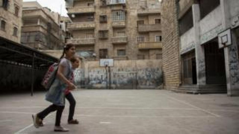 Girls arrive for school in the Shaar district of Aleppo, 7 May