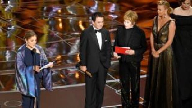 Iranian-born US engineer and astronaut Anousheh Ansari reads out Farhadi's statement