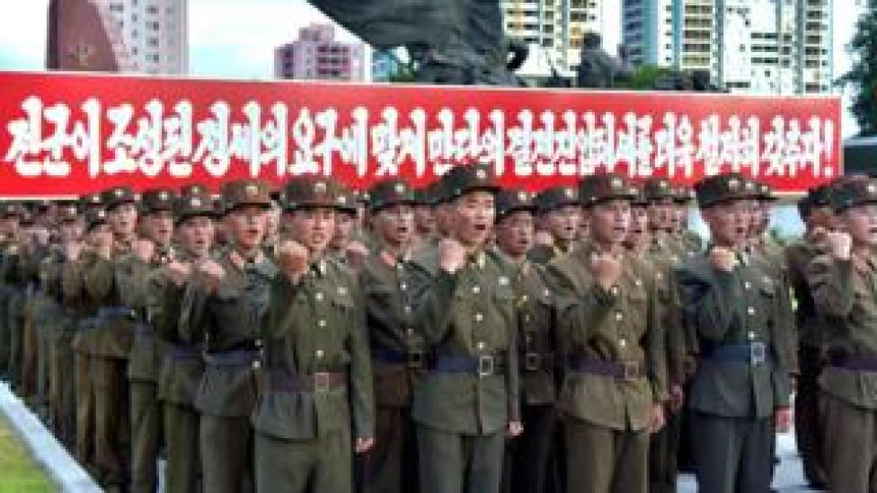 Picture released by KCNA on August 11, 2017 shows service personnel at a rally in Pyongyang