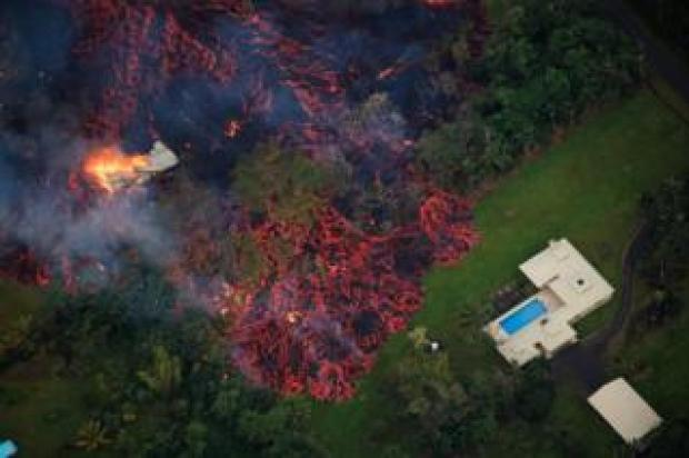 Lava approaches a home near Pahoa, Hawaii