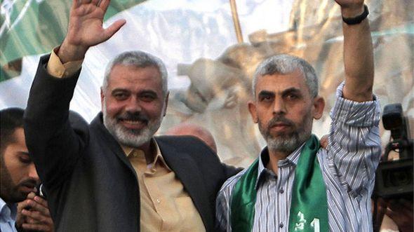 Yehiya Sinwar (right) and Ismail Haniyeh (left)