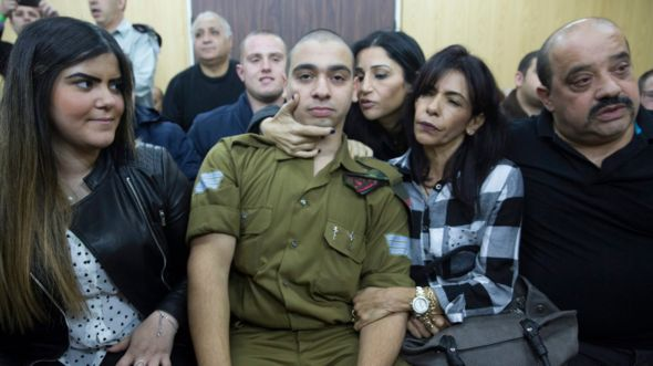 Israeli solider Sgt Elor Azaria sits with his family before hearing the verdict at a military court in Tel Aviv, Israel (4 January 2017)