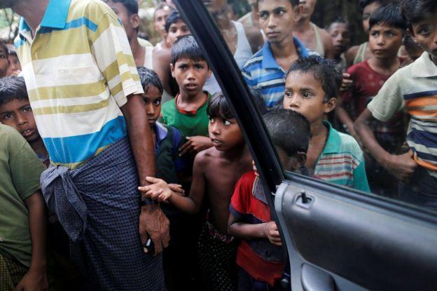 Rohingya Muslim boys stand at U Shey Kya village outside Maugndaw in Rakhine State, Myanmar, 27 October
