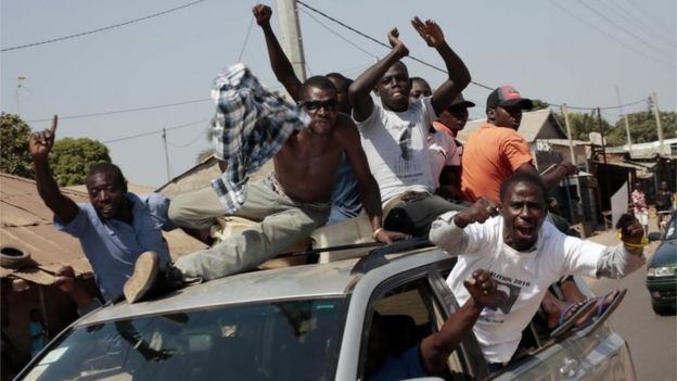 Gambians celebrate the victory of opposition coalition candidate Adama Barrow in the streets of Serrekunda, Gambia, on 2 December 2016