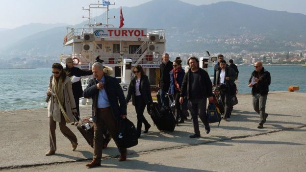 Turkish delegation of observers arrives at port of Mytilene on Greek island of Lesbos (21 March)