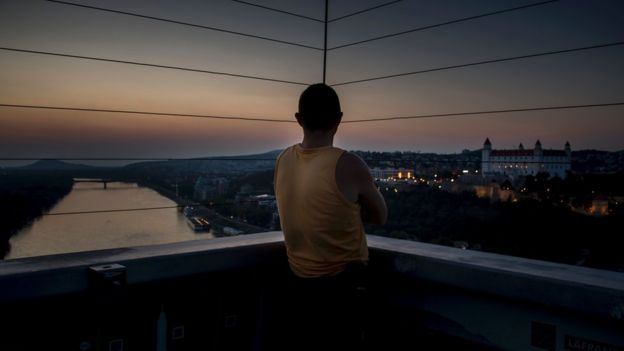 A man looks at Bratislava's castle over the Danube river on the eve of the EU Informal Meeting of the 27 Heads of State in Bratislava on 15 September 2016.