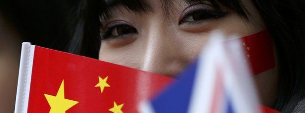Woman holding Chinese flag