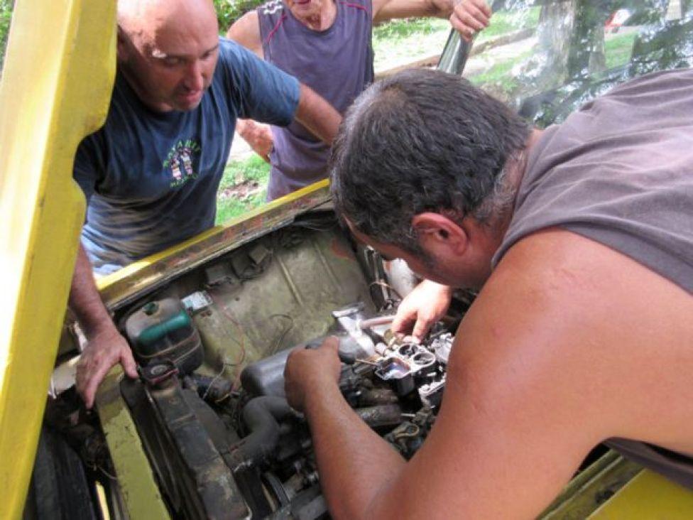 Man fixing a carburettor