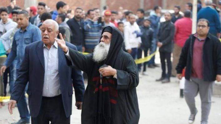 A priest gestures at the site of attack on a church in the Helwan district south of Cairo, Egypt on 29 December 2017