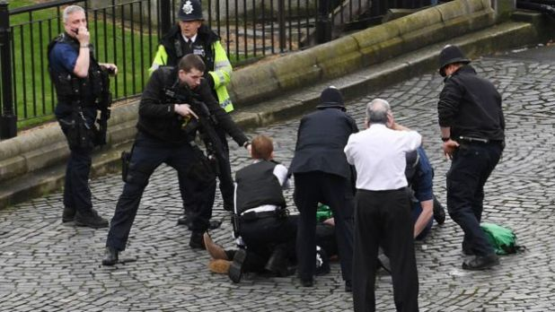 Police surround suspected attacker