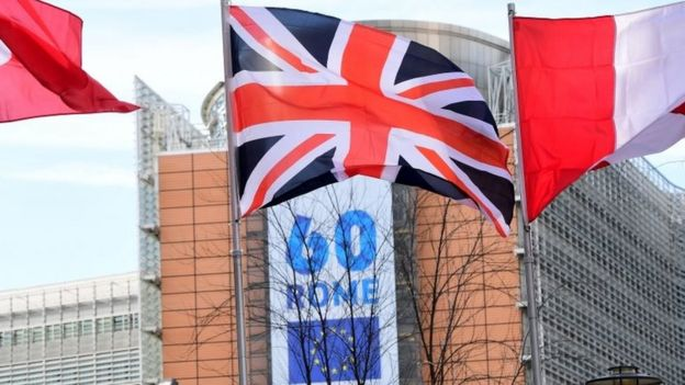 A British flag flies in front of a banner to mark the 60th anniversary of the EU at the European Commission's headquarters in Brussels. Photo: 21 March 2017