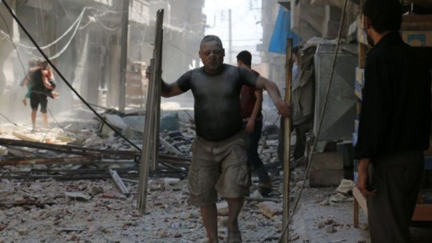 Aftermath of reported air strike on rebel-held district of Sakhur in the northern Syrian city of Aleppo on 15 August 2016
