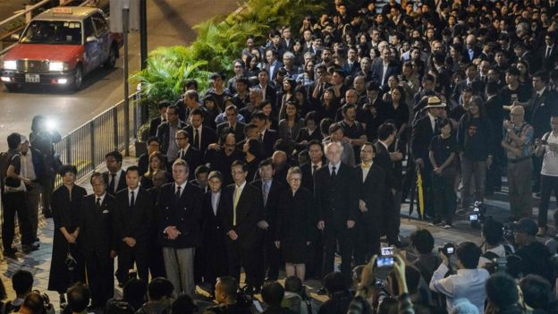 Lawyers and law students take part in a silent march in protest at a ruling by China which effectively bars two pro-independence legislators from taking office in Hong Kong on November 8, 2016