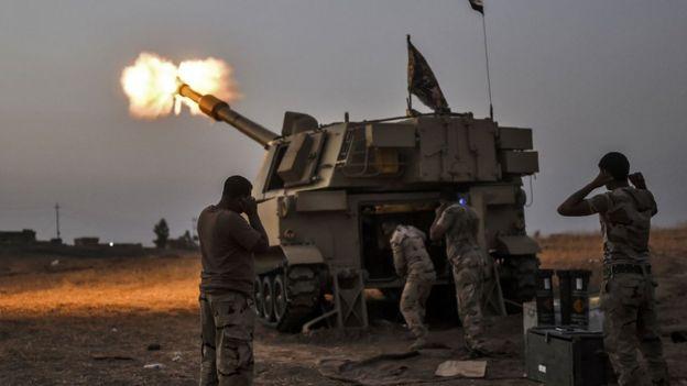 Iraqi forces fire shells on a village near Mosul