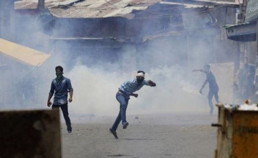 Kashmiri Muslim protesters throw stones at Indian paramilitary soldiers in Srinagar, Indian controlled Kashmir, Sunday, July 10, 2016.