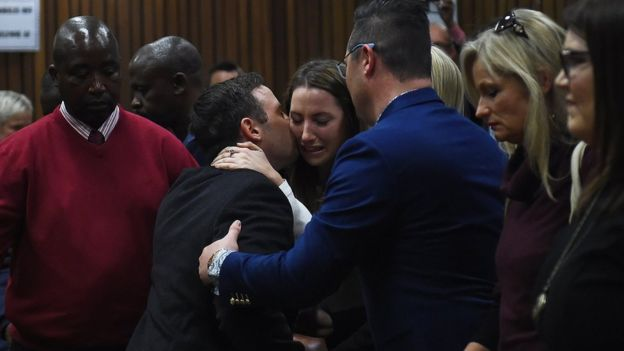 Oscar Pistorius hugs his sister Aimee as he leaves the High Court in Pretoria, South Africa on 6 July