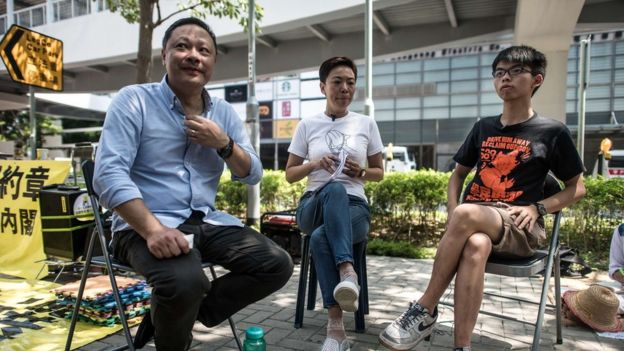 Occupy Central movement co-founder Benny Tai (left) is seen with Joshua Wong (right) and an unnamed woman (centre) during an interview in September 2015, one year on from the start of pro-democracy rallies in Hong Kong