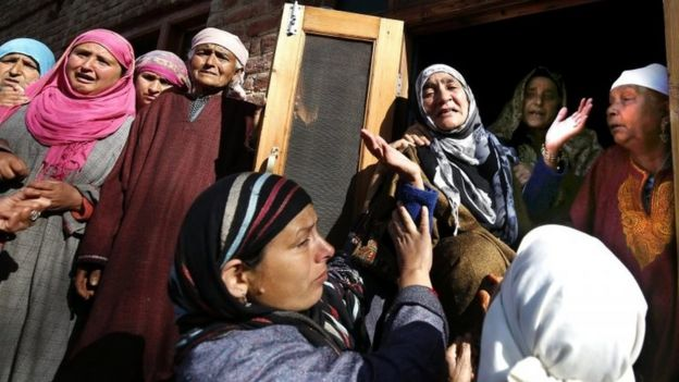 Women wail and mourn during the funeral procession of Raja Begum in Langate near Handwara, 75 kilometers north of Srinagar, the summer capital of Indian Kashmir, 13 April 2016.